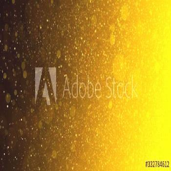 Gold glitter background with bright sparkling circles or blurred bokeh lights on black background,