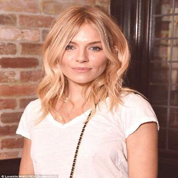 Sienna Miller flashes her legs in playful leather hotpants -  Less is more:In keeping with her ef
