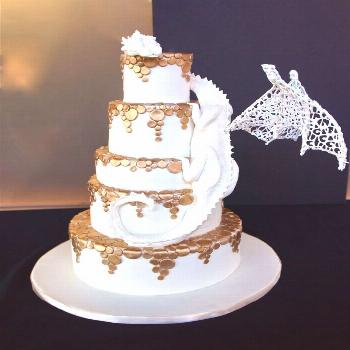 White chocolate dragon wedding cake with golden falling circles and ... ... ,  White chocolate drag