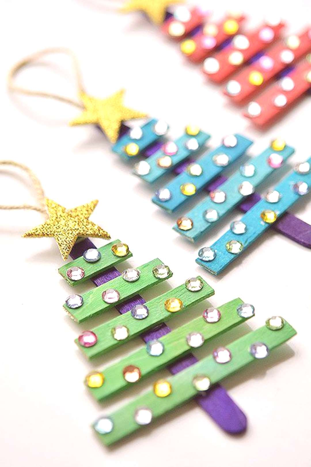 These popsicle stick Christmas trees are SO EASY to make and they're so beautiful! The kids loved d