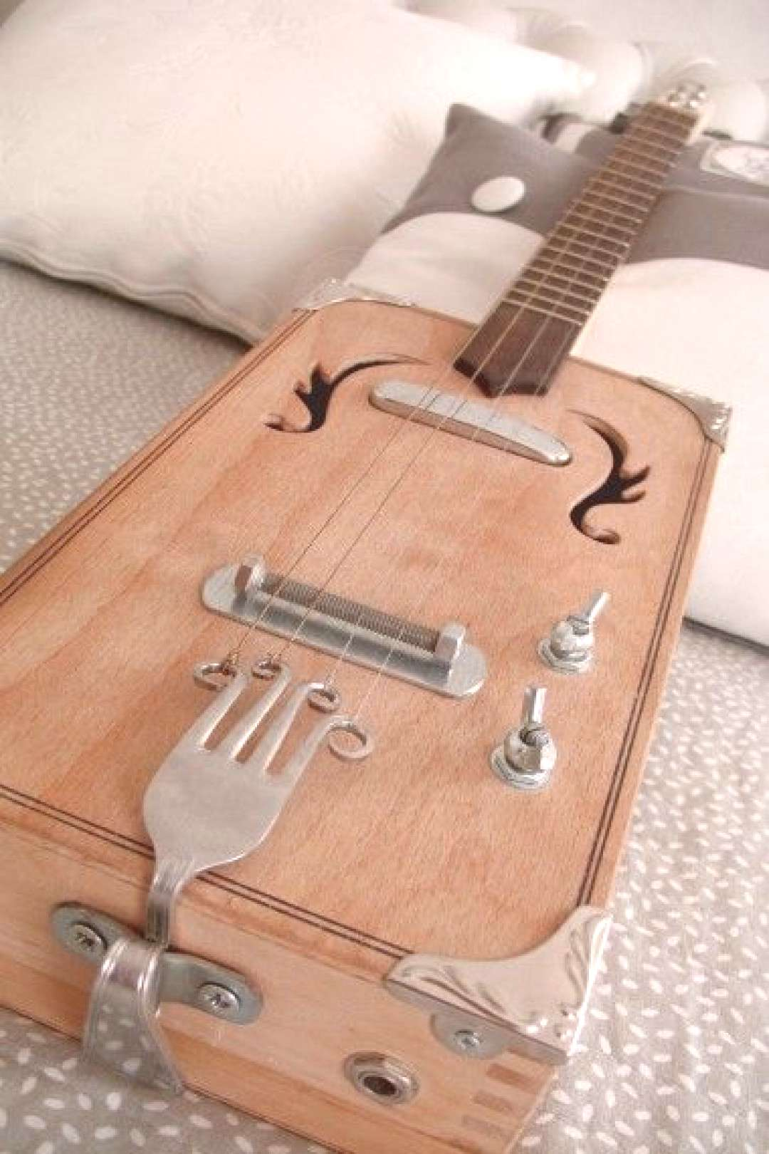 Whoa! Spare guitar parts AND silverware all rolled into an awesome cigar box guitar! Check it out